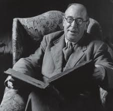 CS Lewis in chair with book