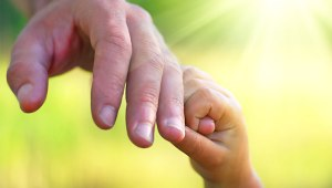 god-the-fathers-hand-holds-the-childs-hand